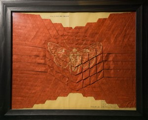 Nepalese lokta paper in red cube fold with gold moth illustration and 1955 cyanotype background